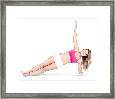 Pilates Instructor On White Background Framed Print by Jorgo Photography - Wall Art Gallery