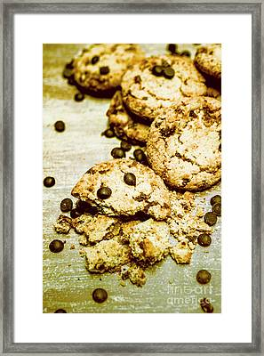 Pile Of Crumbled Chocolate Chip Cookies On Table Framed Print by Jorgo Photography - Wall Art Gallery