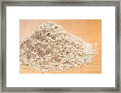 Pile Of Dried Rolled Oat Flakes Spilled  Framed Print by Arletta Cwalina