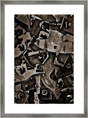 Pile Of Metal Parts Framed Print by Stuart Litoff
