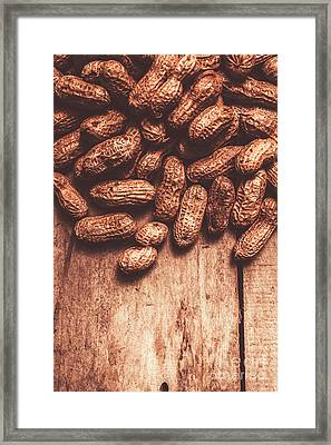 Pile Of Peanuts Covering Top Half Of Board Framed Print by Jorgo Photography - Wall Art Gallery