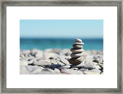 Pile Of Stones On Beach Framed Print by Dhmig Photography