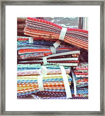 Piles Of Fabric Framed Print by Tom Gowanlock