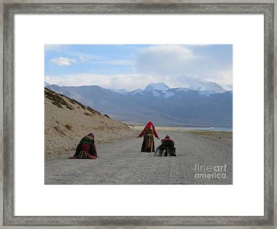 Pilgrims Prostrating Around Sacred Lake Mansarovar, Tibet Framed Print by Mikhael van Aken
