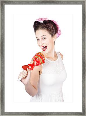 Pin-up Girl Singing Into Large Lollypop Microphone Framed Print by Jorgo Photography - Wall Art Gallery