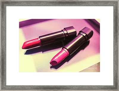 Pink And Rouge Lipsticks On Table Framed Print by Jorgo Photography - Wall Art Gallery