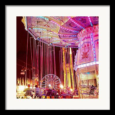 Surreal Hot Pink Yellow Carnival Rides Framed Prints