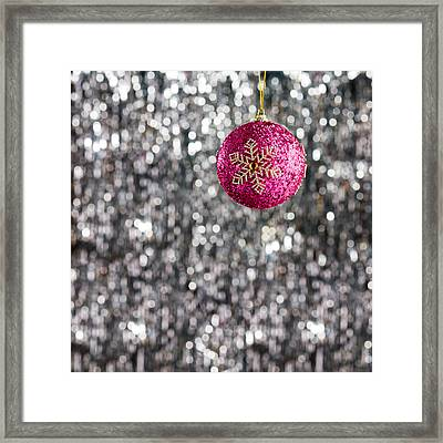 Framed Print featuring the photograph Pink Christmas Bauble by Ulrich Schade