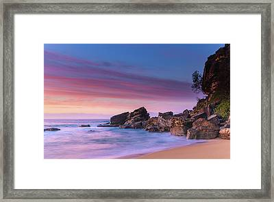 Pink Clouds And Rocky Headland Seascape Framed Print