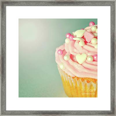 Framed Print featuring the photograph Pink Cupcake With Lovehearts by Lyn Randle