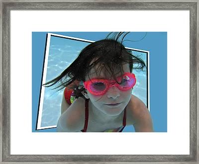 Pink Speedo's Framed Print by Susan Leggett