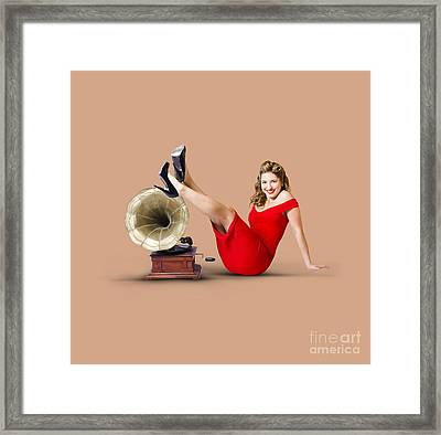 Pinup Girl In Red Dress Playing Classical Music Framed Print by Jorgo Photography - Wall Art Gallery