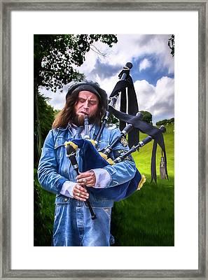 Pipers Gotta Pipe Framed Print by John Haldane