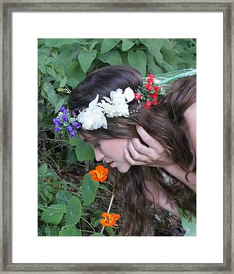 Pixie Smelling A Poppy Framed Print