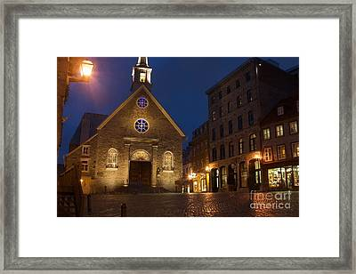 Place Royale And Notre-dame-des-victoires Church At A Rainy Evening Framed Print