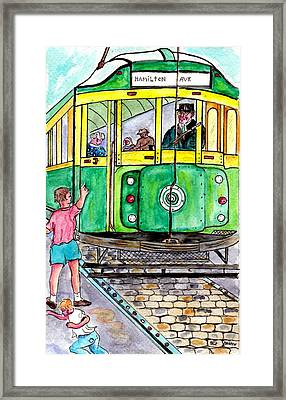 Placing Bottle Caps On The Trolley Tracks Framed Print