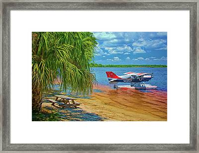 Framed Print featuring the photograph Plane On The Lake by Lewis Mann