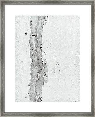 Plaster On A Wall Framed Print