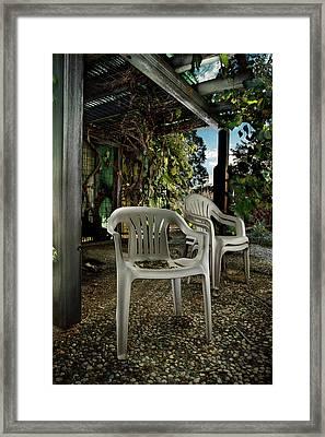 Plastic Chairs Framed Print by Yo Pedro