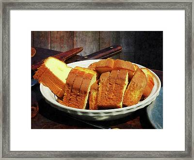 Plate With Sliced Bread And Knives Framed Print by Susan Savad
