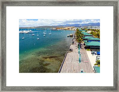 Playa De Ponce Framed Print by George Oze