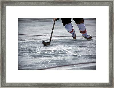 Player And Puck Framed Print by Karol Livote