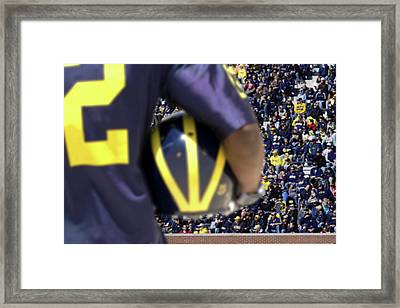 Player Cradling Helmet In Stadium Framed Print