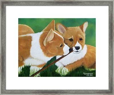 Playful Corgis Framed Print by Debbie LaFrance