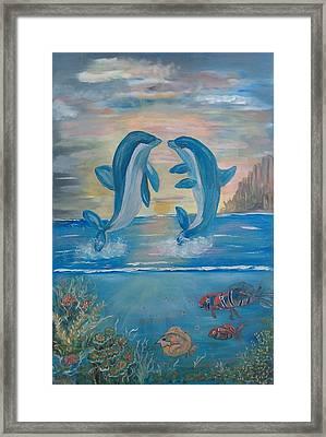 Playful Dolphins Framed Print by Mikki Alhart