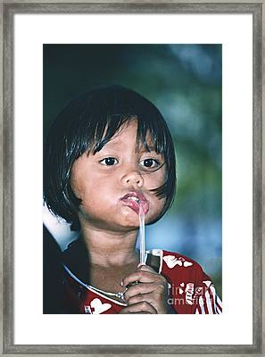 Framed Print featuring the photograph Playful Little Girl In Thailand by Heiko Koehrer-Wagner