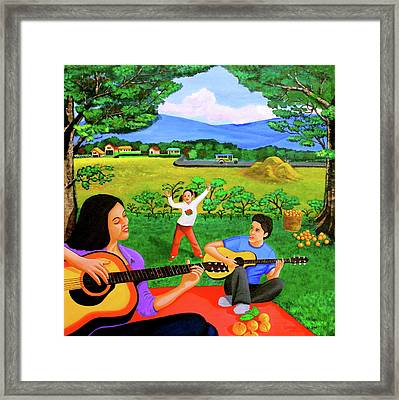 Playing Melodies Under The Shade Of Trees Framed Print by Lorna Maza