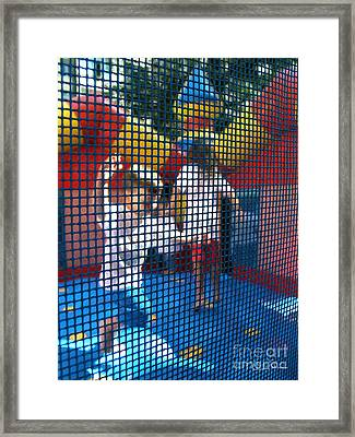Playing Safe Framed Print by Carlos Alvim