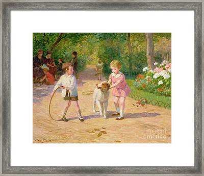 Playing With The Hoop Framed Print by Victor Gabriel Gilbert
