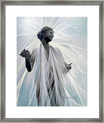 Plaza Lady Framed Print by Faye English