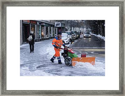 Ploughing The Snow  Framed Print