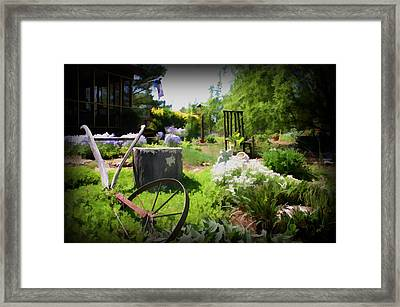 Plow In The Garden Framed Print