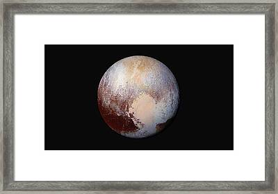 Pluto Dazzles In False Color Framed Print by Nasa