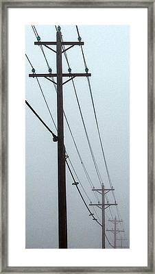 Poles In Fog - View On Left Framed Print by Tony Grider