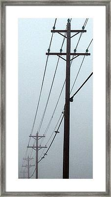 Poles In Fog - View On Right Framed Print by Tony Grider