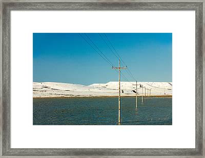 Poles Submerged Framed Print by Todd Klassy