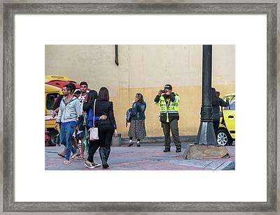 Police Officer Taking Picture Framed Print