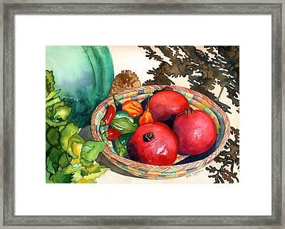 Pomegranates And Basket Framed Print by Eunice Olson