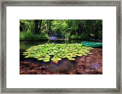 Pond With Water Lilies And A Footbridge Framed Print by George Oze