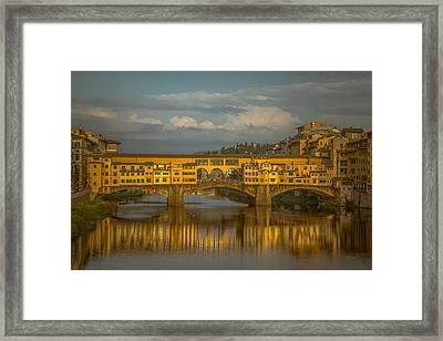 Ponte Vecchio As The Sun Sets Framed Print by Chris Fletcher