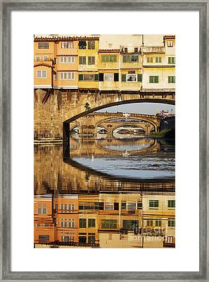 Ponte Vecchio Crossing The River A Framed Print by Jeremy Woodhouse