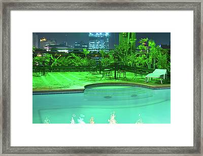 Pool With City Lights Framed Print