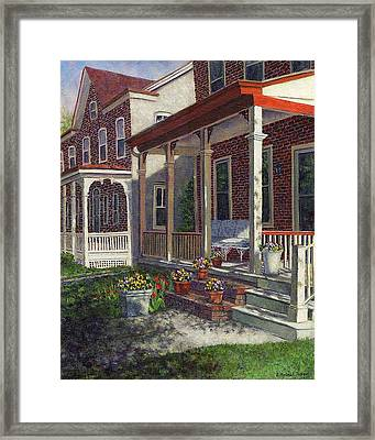 Porch With Pots Of Pansies Framed Print by Susan Savad