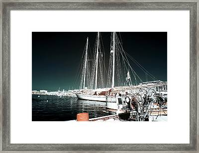 Port Sailboat Framed Print by John Rizzuto