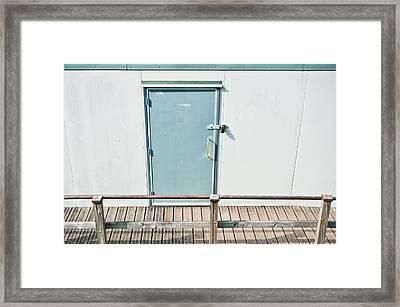 Portcabin Door Framed Print by Tom Gowanlock