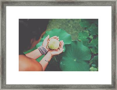 Portrait Of A Girl Holding Gently A Lotus Flower In Her Hands Framed Print